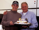 Jenson Button celebrates his 20th birthday during his first F1 test with his father John