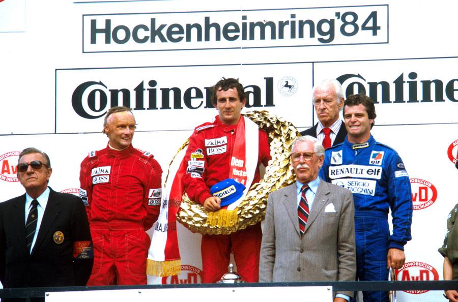 Niki Lauda, Alain Prost and Derek Warwick on the podium