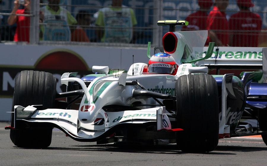 Rubens Barrichello catches a slide in the Honda RA108