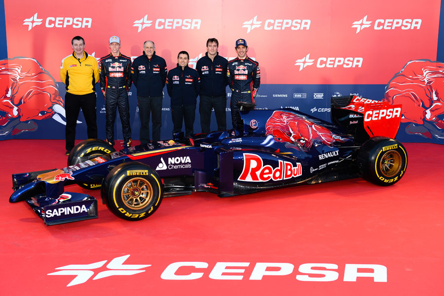 The Toro Rosso team pose for a photo with the STR9