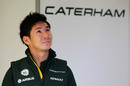 Kamui Kobayashi checks the timing screens in the garage