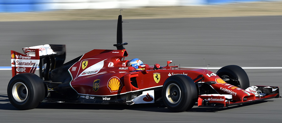 A side view of Fernando Alonso putting the F14 T through its paces