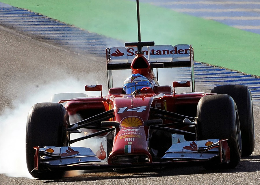 Easy Fernando... Alonso locks up in the F14 T