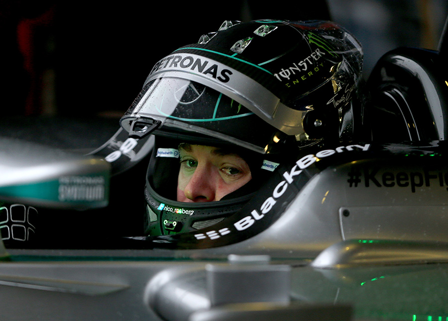 Nico Rosberg sits in the cockpit of the W05