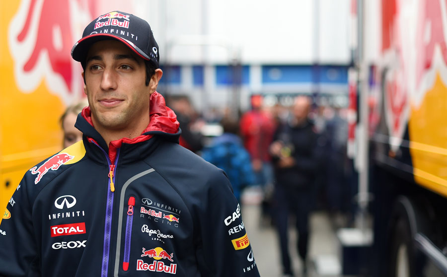 Daniel Ricciardo walks through the paddock after his day of testing was cut short