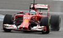 Fernando Alonso drives through the wet