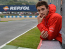 After a tough day Jules Bianchi watches on from the pit wall
