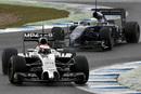 McLaren's Kevin Magnussen with Felipe Massa's Williams in close quarters