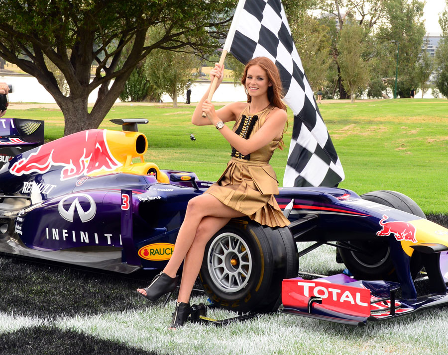 Australian model Georgia Geminder poses with a Red Bull at an event to promote the Australian Grand Prix