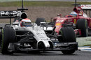 McLaren's Kevin Magnussen leads Fernando Alonso through the chicane