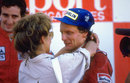 Niki Lauda is congratulated by wife Marlene after sealing his third world title