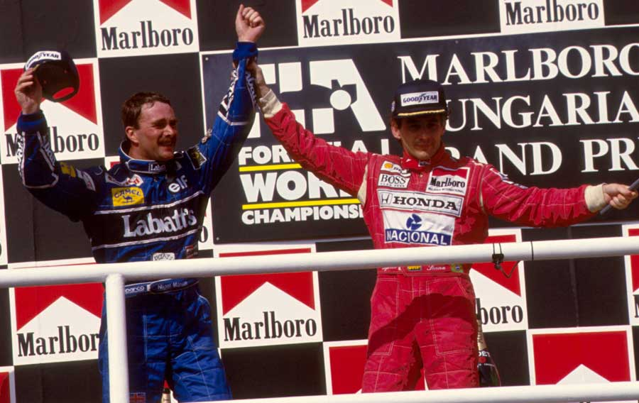 Ayrton Senna congratulates Nigel mansell on clinching the drivers' title in Hungary