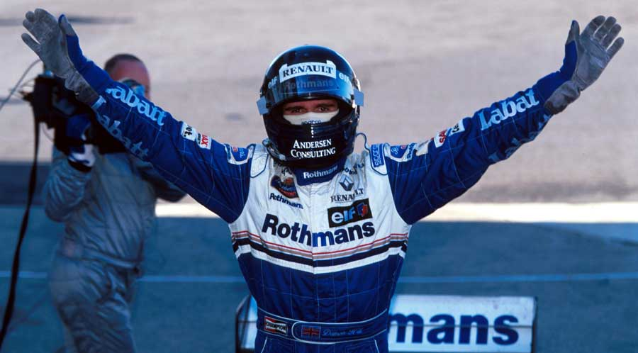 Damon Hill celebrates clinching the drivers' championship with victory in Suzuka