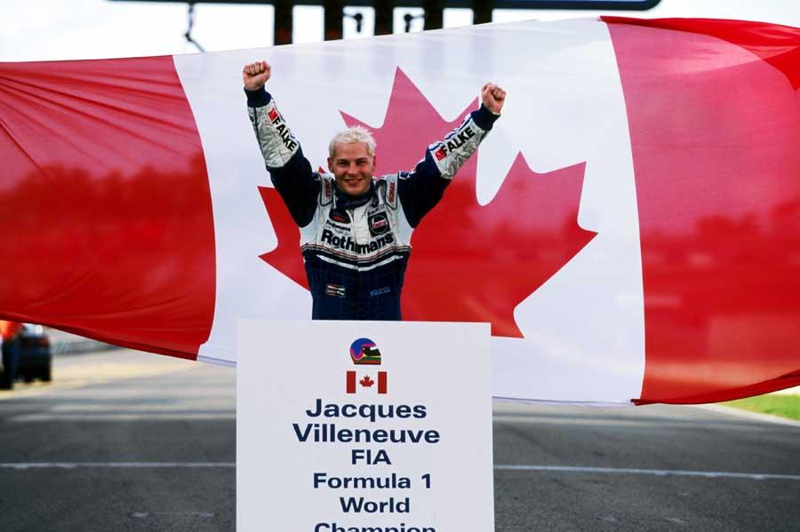 Jacques Villeneuve celebrates winning the 1997 drivers' world title