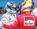Michael Schumacher congratulates Mika Hakkinen on winning the drivers' title