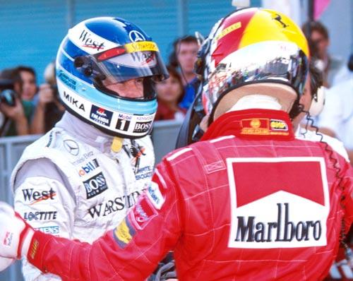 Michael Schumacher congratulates Mika Hakkinen on winning the drivers' title
