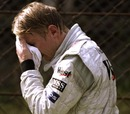 A distraught Mika Hakkinen thinks he has blown his title hopes after crashing out in Monza