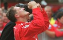 Michael Schumacher celebrates winning Ferrari's first drivers' title since 1979