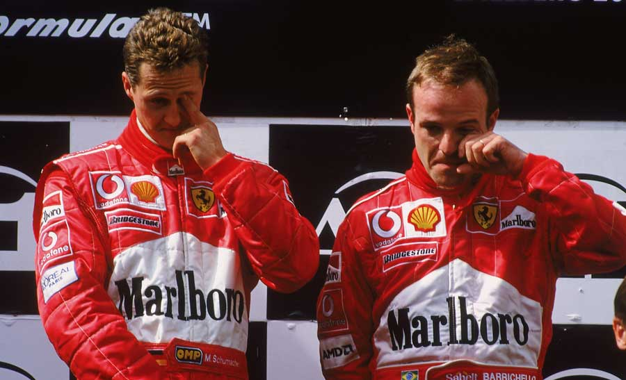An embarrassed Michael Schumacher and Rubens Barrichello on the podium after the 2002 Austrian Grand Prix