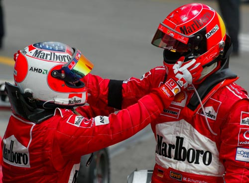 Rubens Barrichello congratulates team-mate Michael Schumacher for winning the 2003 San Marino Grand Prix