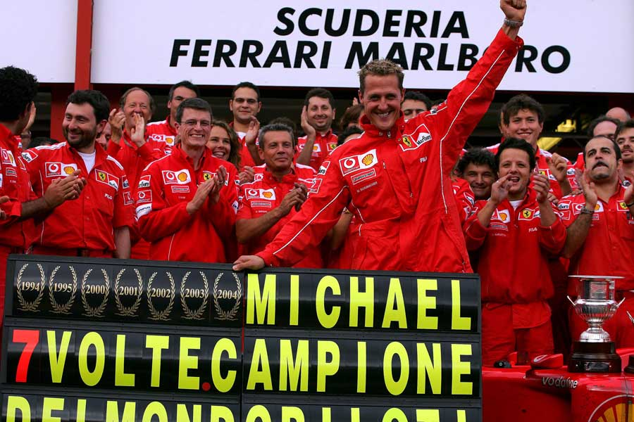Michael Schumacher celebrates winning his seventh drivers' title at Spa