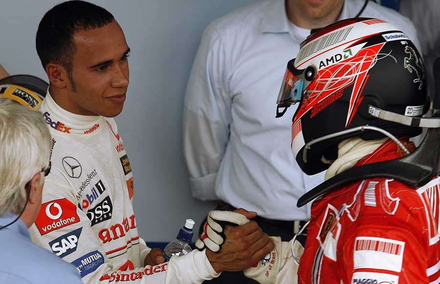 Lewis Hamilton congratulates Kimi Raikkonen on beating him to the drivers' title in Brazil