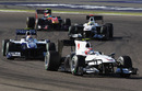 Kamui Kobayashi leads a gaggle of cars in Bahrain