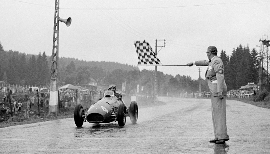 Alberto Ascari crosses the line to win the Belgian Grand Prix