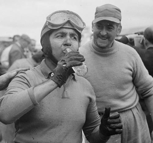 Alberto Ascari quenches his thirst after wining the British Grand Prix
