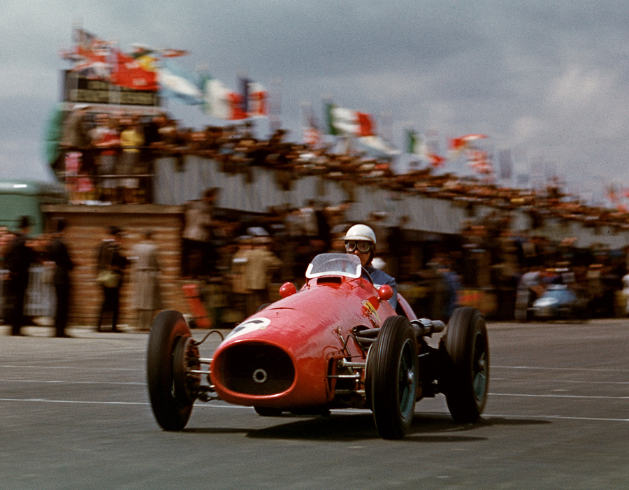 Alberto Ascari crosses the line to win the British Grand Prix
