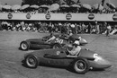 Juan Manuel Fangio's Maserati is sandwiched by the Ferraris of Alberto Ascari and Giuseppe Farina