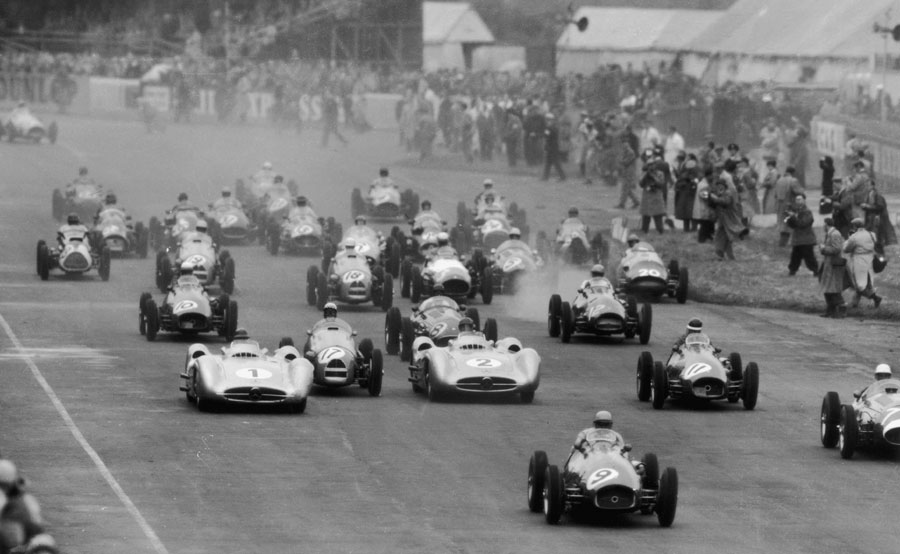 Jose Froilan Gonzalez (No. 9) leads the field away at the start of the 1954 British Grand Prix