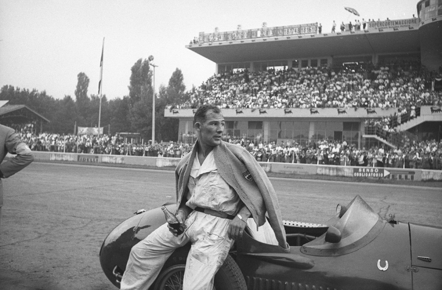 Stirling Moss pushed his car across the line for 10th at the Italian Grand Prix