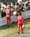 Ayrton Senna and  Alain Prost head back to the pits after their collision