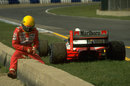 Ayrton Senna sits on a wall at the side of the track