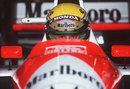 Ayrton Senna sits in his car ahead of the US Grand Prix