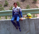 Ayrton Senna waits to be picked up after his Williams collided with Mika Hakkinen's McLaren