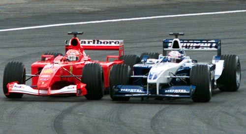 Juan Pablo Montoya pulls off an audacious overtaking move on Michael Schumacher