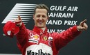 Michael Schumacher celebrates winning the inaugural Bahrain Grand Prix