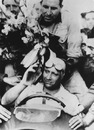 Juan Fangio takes the plaudits at the French Grand Prix at Rheims