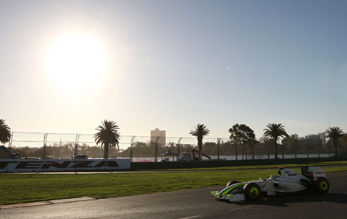 Jenson Button on his way to victory as the sun sets