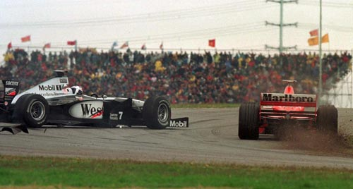 Michael Schumacher forces David Coulthard wide during the Argentinean Grand Prix