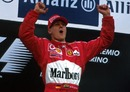 Michael Schumacher takes his customary leap after winning the San Marino Grand Prix