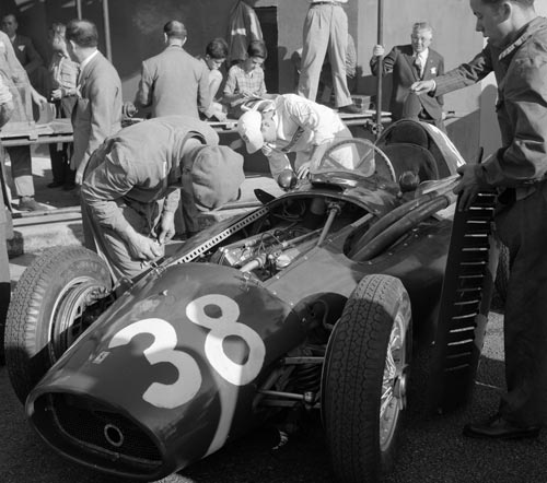 Mechanics work on Mike Hawthorn's Ferrari 553 'Squalo', which would win the Spanish Grand Prix