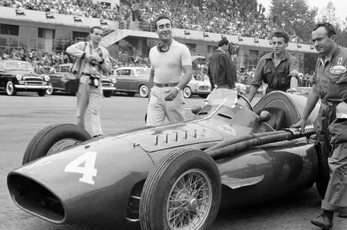 Eugenio Castellotti with his Ferrari 'Squalo' walking to the grid before the start of the Italian Grand Prix at Monza