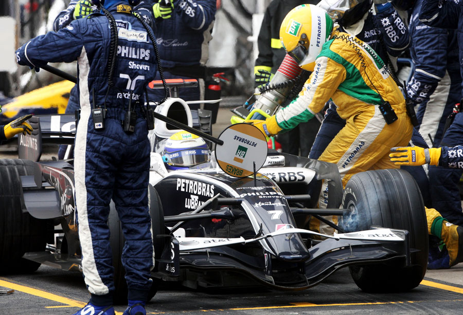 The fuel goes in as Nico Rosberg waits to be released from the pits