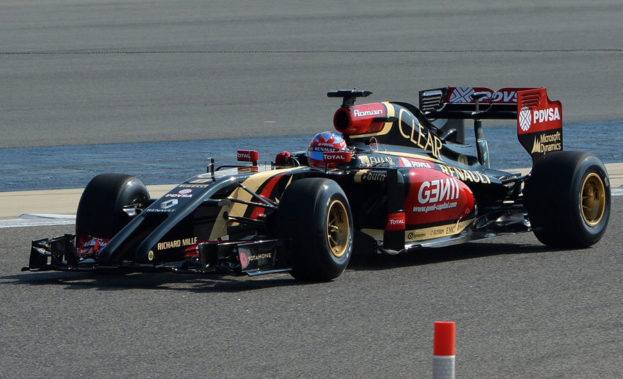 Romain Grosjean on track in the new Lotus E22