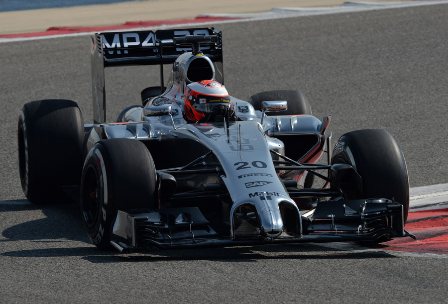 Kevin Magnussen clips the apex in the McLaren MP4-29