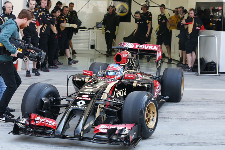 Romain Grosjean leaves the pits for the first time in the Lotus E22