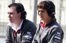 Sauber's Esteban Gutierrez (right) watches proceedings from the pit lane